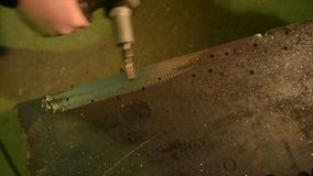 Deburring a metal part. Slow camera movement stock video footage