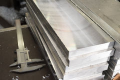 Deburring of steel plates after milling. In his hand a simple cu Royalty Free Stock Images