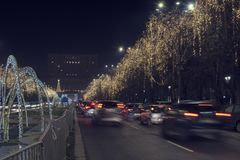 13 DEC 2018, Romania, Bucharest. Bulevardul Unirii Christmas lights and traffic in front of the Parliament. Long exposure image. Selective focus royalty free stock photo