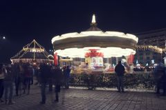 13 DEC 2018, Romania, Bucharest. Carousel at Christmas Fair at Romanian Parliament in Bucharest. Long exposure image. Selective focus royalty free stock photography