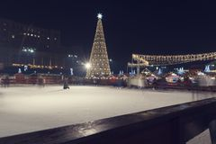13 DEC 2018, Romania, Bucharest Christmas Market at the Parliament. Ice skating. Festive night and beautiful Christmas tree. Long. Exposure. Selective focus royalty free stock image