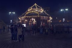 13 DEC 2018, Romania, Bucharest. House of Santa Claus at Christmas Market at Romanian Parliament. Long exposure image. Selective focus stock image