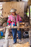 Dec 27th 2015, Cusco Peru: An unidentified peruvian old man making a craftmanship of wood cup, Cusco Peru. An unidentified old man making a craftmanship of wood stock images