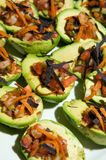 Decadent avocado halves topped with pico de gallo Royalty Free Stock Photos