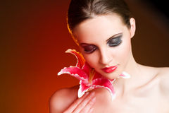 Decadent beauty. Decadent beauty, colorful portrait of gorgeous young brunette with colorful flower Royalty Free Stock Photo
