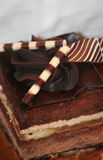 Decadent Chocolate Cake. A decorative piece of rich, layered, chocolate mousse cake Stock Photo