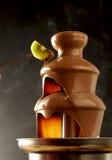 Decadent chocolate fondue fountain Royalty Free Stock Photos