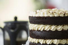 Decadent Chocolate Layer Cake with Coffee Urn Royalty Free Stock Photos