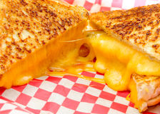 Decadent grilled cheese sandwiches. With oozing cheese running out with ketchup for dipping Royalty Free Stock Photography