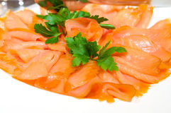 Decadent slices of smoked salmon. An image of decadent slices of smoked salmon with garnishes Stock Photography