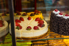 Decadent Strawberry Cheesecake in Window Display Royalty Free Stock Photos