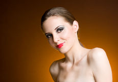 Decadent young brunette. Portrait of a beautiful friendly young brunette in heavy makeup Royalty Free Stock Image