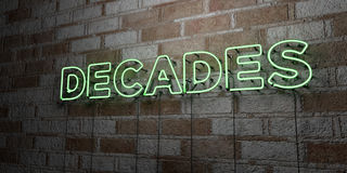 DECADES - Glowing Neon Sign on stonework wall - 3D rendered royalty free stock illustration Royalty Free Stock Photography