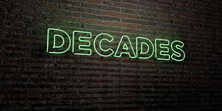 DECADES -Realistic Neon Sign on Brick Wall background - 3D rendered royalty free stock image Royalty Free Stock Image