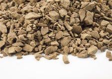 Decaf coffee powder. Close focus on premium brown decaf coffee powder putting on white floor royalty free stock photo