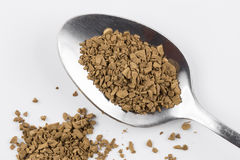 Decaf coffee powder on teaspoon. Close focus on premium brown decaf coffee power putting on stainless steel teaspoon and white background royalty free stock image