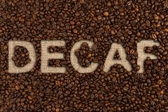 Decaf concept written on coffee beans Stock Photography