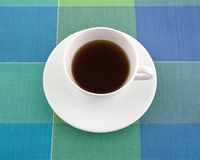 Decaffeinated black tea in a cup on a place mat. Stock Photo