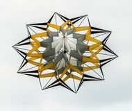 Decagonal kite against a cloudy sky Stock Photos
