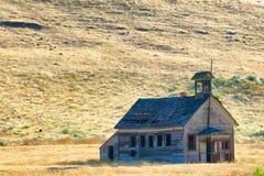 Decaimiento de una casa de la escuela del sitio Fotografía de archivo libre de regalías