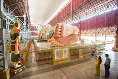 15 Decamber 2016 YAGON, MYANMAR Burmese people and tourist come to pray and take photo with Chauk Htat Gyi Reclining Buddha Image royalty free stock image