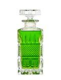 Decantatore con liquido verde fotografia stock libera da diritti
