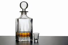 Decantatore e vetro del whisky Fotografia Stock