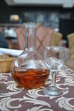 Decanter of cognac and empty glass. Still life: a decanter of cognac and empty glass on the restaurant table Royalty Free Stock Photos