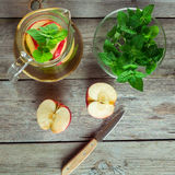 Decanter cool green tea with mint and cut apple Stock Images