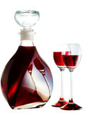 Decanter filled with liquor. Decanter filled with red liquor Stock Images