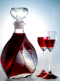 Decanter filled with liquor Stock Images