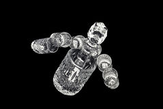 Decanter with jiggers for alcoholic beverage. Crystal decanter with jiggers for alcoholic beverage over black background Stock Photos