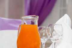 Decanter with juice on a table at restaurant Stock Photos