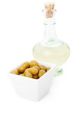 Decanter of  oil and olives Stock Photography