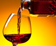 Decanter and  snifter of brandy . Stock Images