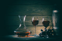 Decanter, two glasses of red wine and barrel stock photos