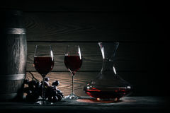 Decanter, two glasses of red wine and wooden barrel stock images