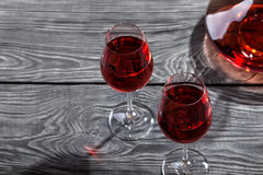 Decanter and two glasses of red wine on a wooden table royalty free stock photo