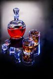 Decanter and two glasses with whisky and ice Stock Images