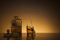 Decanter of whiskey and a glass Stock Images