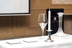 Decanter, wine glass, candle for wine tasting. In the restaurant Royalty Free Stock Photography