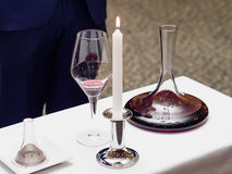 Decanter, wine glass, candle for wine tasting. In the restaurant Stock Photos