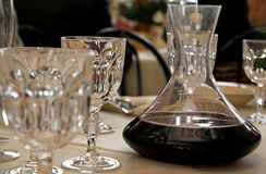 Decanter with wine in a table with glass Royalty Free Stock Photography