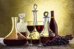 Decanters with red wine and glass Royalty Free Stock Photo