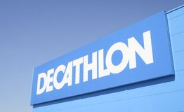Decathlon sports store logo. French sports goods chain store Decathlon logo on a blue sky stock images