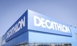 Decathlon sports store logo. French sports goods chain store Decathlon logo on a blue sky royalty free stock images