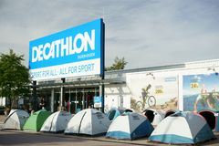 Decathlon store entrance Customers Germany. Entrance of a Decathlon store in Germany. Rows of camping tents displayed outdoor. Worlds largest French sporting royalty free stock photography