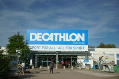 Decathlon store entrance Customers Germany. Entrance of a Decathlon store in Germany. People, camping tents, blue sky. Worlds largest French sporting goods royalty free stock photo