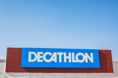 Decathlon store retail chain brand logo. SAGUNTO, SPAIN - FEBRUARY 08, 2019: Decathlon store is a French company of sporting goods distribution retail chain stock photos