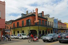 Decatur Street in French Quarter, New Orleans. Historic Buildings at the corner of Decatur Street and Madison Street in French Quarter in New Orleans, Louisiana stock photography